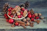 basket of Christmas toys and walnuts. still life with  new year feast. close up, soft focus - 232085470