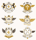 Vintage heraldry design templates, vector emblems created with bird wings, crowns, stars, armory and animal illustrations. Collection of vintage style symbols. - 232098681