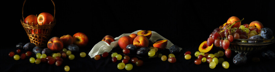 Large-format panorama-still life with fruit on a dark background © parsadanov