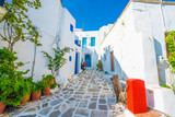 Old traditional white houses on the street in Lefkes village, Paros, Greece - 232100483