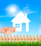 Creative Template Design for Real Estate. Hand holding a paper house. Vector illustration. - 232102215