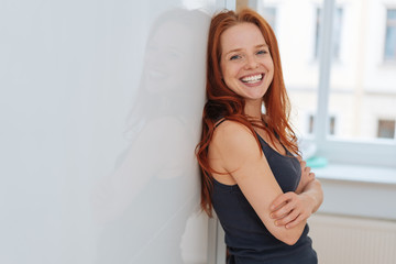 Cute young woman with a beaming happy smile