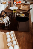 high angle view of frying pan with scrambled egg on stove in kitchen