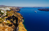 A panoramic image from Santorini of the villages of Fira and Firastefani with a view of the caldera in between them.