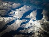 Alps from plane window. - 232116085