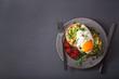 Leinwanddruck Bild - breakfast avocado sandwich with fried egg and tomato