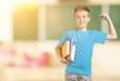 Leinwandbild Motiv Cute little schoolgirl in glasses on blackboard background