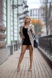 Girl with perfect legs in pantyhose at the city square. - 232122899