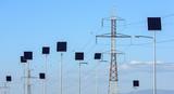 Street lighting works from solar panels, blue sky background. Before electricity transmission pylon. - 232126477