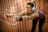 Pretty young woman stretching during sport training - 232134866