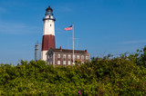 The United States Flag Flies High at Montauk Lighthouse on New York's Long Island