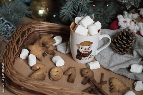 Poster Cup with the image of a pig and a cookie in the form of a figure 2019 in honor of Christmas and the new year