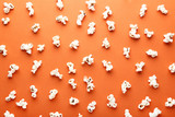 Salted popcorn on orange background - 232159825