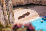 Navagio beach with shipwreck and flowers on Zakynthos island, Greece - 232166879