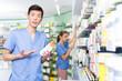 Leinwanddruck Bild - Portrait of korean man pharmacist standing with medicines