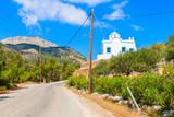 White typical church along road on Karpathos island, Greece - 232174092
