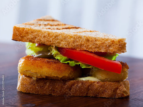 Foto Murales Sandwich with  bread, chicken nuggets, tomatoes and lettuce