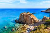 Walkway to beautiful bay with beach in Ammopi village on sea coast of Karpathos island, Greece
