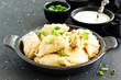 dumplings with potatoes in onion and bacon sauce. Varenyky, vareniki, pierogi, pyrohy. - 232179489
