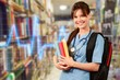 Leinwanddruck Bild - Attractive young female medical student with backpack and books