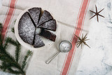 Christmas cake or Chocolate Brownie and decorations on white table