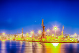 Port Cranes Working in Heraklion City in Greece at Blue Hour Time. - 232193673