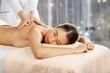 Leinwanddruck Bild - Beautiful young woman relaxing with massage at