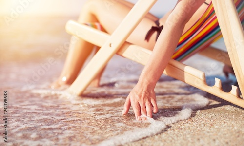 Woman at beautiful beach relaxing on the chair - 232198638