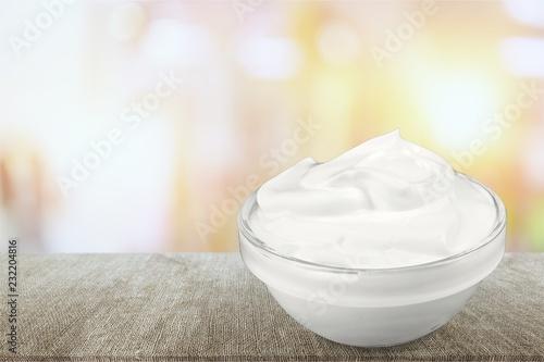 Leinwanddruck Bild close up of a white beauty cream or yogurt on white background
