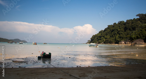 Foto Murales beach with rocks and sky with effects of photography