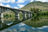 Bridge reflections in still river © Craig