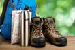 Hiking boots, backpack and map  on background