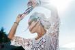 Leinwanddruck Bild - Windy weather. Beautiful African-American woman with white dreadlocks enjoying the windy weather