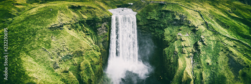 Iceland waterfall Skogafoss banner nature landscape. Panoramic destination in Icelandic famous world landmark tourist attraction on South Iceland. Aerial drone view of top waterfall. - 232210695
