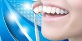 Woman teeth and a dentist mouth mirror on background - 232214247