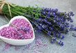 Heart-shaped bowl with sea salt and fresh lavender flowers