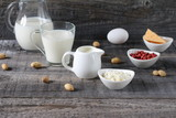 Breakfast on the table. Composition of dairy products on a wooden background. - 232245019