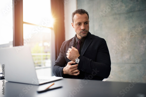 Foto Murales Pensive businessman working with a laptop in office
