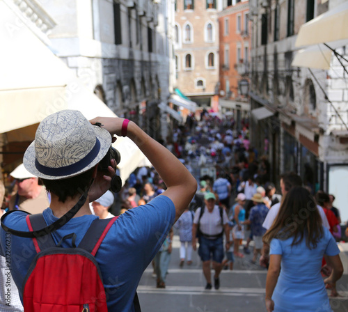 Young photographer on Rialto Bridge in Venice Italy - 232266233