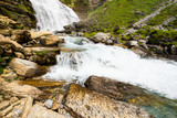 Water cascades between mountains in Ordesa National Park, Spain. Lanscape with waterfall.