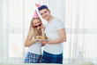 Couple with a cake with candles congratulates on his birthday on
