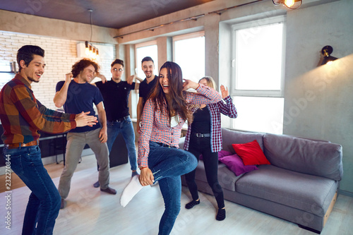 Friends dance fun at a student's party in the apartment - 232270844