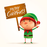 Little elf holds a wooden board with Christmas greetings. Isolated.