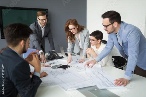 Group of architects working on project in office