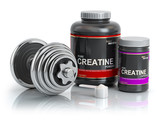 Creatine powder with scoop and dumbbell.Bodybuilder nutrition(supplement) concept. - 232292042