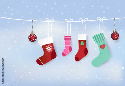 Paper art illustration of stockings hanging on clothesline and snow