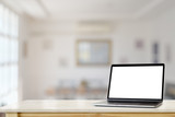Mockup Blank screen laptop on table with living room background. - 232293401