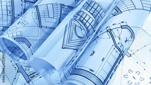 Blueprints - rolls of architectural drawings smoothly rotate on the surface of the architectural plan of a modern house / seamless looping