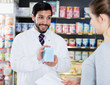 Leinwanddruck Bild - apothecary is recommending medicine for  woman