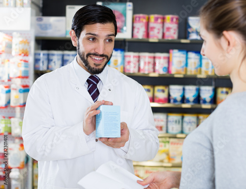 Leinwanddruck Bild apothecary is recommending medicine for  woman